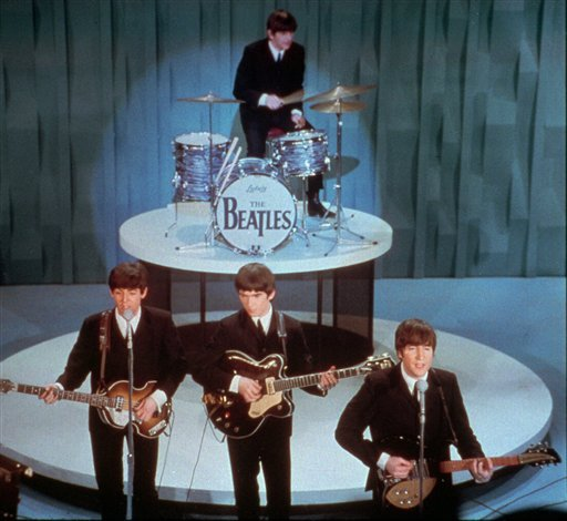 "FILE - In this Feb. 9, 1964 file photo, The Beatles, front row from left, Paul McCartney, George Harrison, John Lennon and Ringo Starr on drums, perform at the ""Ed Sullivan Show,"" in New York."