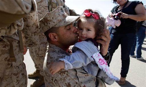 Sgt. Jose Castaneda kisses his daughter Makyla as he returns from a tour in Afghanistan Monday, March 28, 2011, at Camp Pendleton, Calif. (AP)