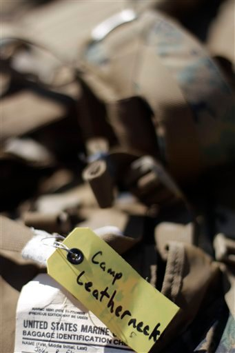 "A bag is marked with a tag that reads, ""Camp Leatherneck,"" as a group of Marines return from a tour in Afghanistan Monday, March 28, 2011, at Camp Pendleton, Calif. (AP)"