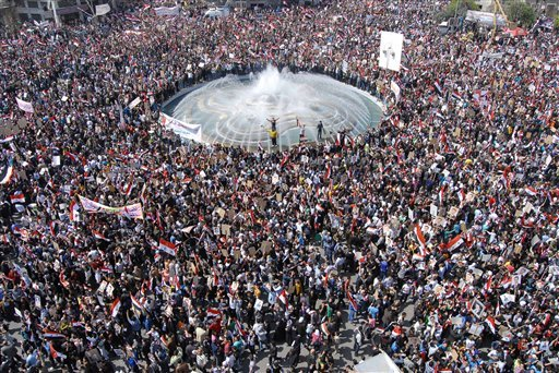 Pro-Syrian President Bashar Assad supporters gather to demonstrate their support for their president, in Damascus, Syria, on Tuesday March 29, 2011. (AP)