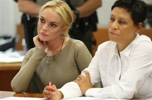 Lindsay Lohan is seen with her attorney, Shawn Chapman Holley at Los Angeles Superior Court, Thursday, March 10, 2011.