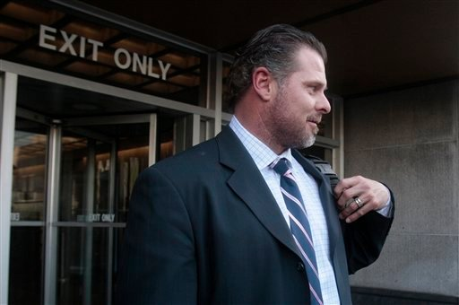 Colorado Rockies first baseman Jason Giambi leaves federal court after testifying in the perjury trial of former baseball player Barry Bonds in San Francisco, Tuesday, March 29, 2011.