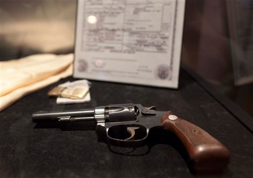 A hand gun that once allegedly belonged to mobster Bugsy Siegel is seen on display at the Mob Experience at the Tropicana, Monday, March 28, 2011, in Las Vegas. (AP Photo/Julie Jacobson)