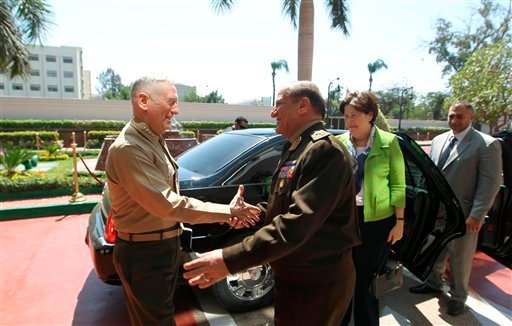 Egyptian Chief of Staff of the Armed Forces Sami Anan, right, shakes hands with Marine Gen. James Mattis, commander of U.S. Central Command in Cairo, Egypt, Tuesday, March 29, 2011. (AP Photo/ Khaled Desouki, Pool)