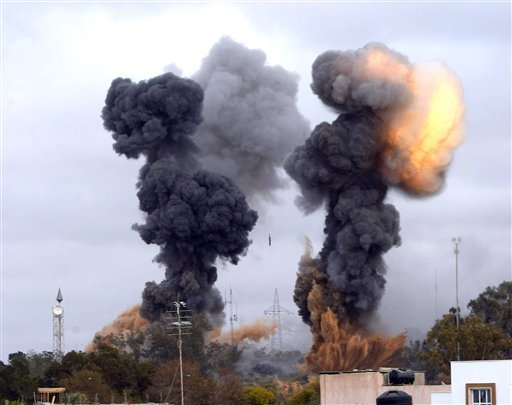In this photo released by China's Xinhua news agency, heavy smoke rises over the Tajoura area, some 30 km east of Tripoli, Libya, after an airstrike on Tuesday March 29, 2011. (Xinhua/Hamza Turkia)