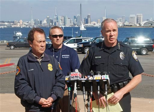 John Bolduc, right, Chief of the San Diego Harbor Police, makes a statement at a news conference Monday, March 28, 2011 in San Diego.
