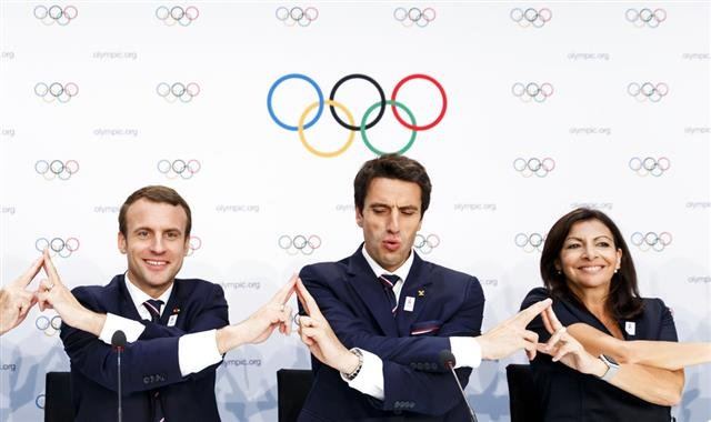 French President Emmanuel Macron, left, and Paris 2024 Olympic bid co-president Tony Estanguet, center, and Mayor of Paris Anne Hidalgo, right, attend a press conference after the presentation of Paris 2024 Candidate City Briefing for International Olympi