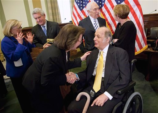 Former White House press secretary James Brady, right, who was left paralyzed in the Reagan assassination attempt, shakes hands with Robyn Ringler, who was a nurse to President Reagan at George Washington University Hospital, Wednesday, March 30, 2011.