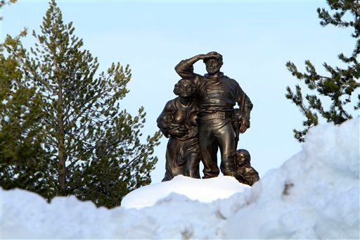 In this photo taken Monday, March 28, 2011, the Pioneer Memorial, dedicated to the Donner Party, is seen behind snow cleared from the parking lot at the Donner Memorial State Park at Truckee, Calif.