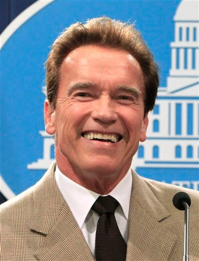 "FILE - In this Dec. 6, 2010 file photo, then California Gov. Arnold Schwarzenegger smiles during a during a news conference in Sacramento, Calif. Schwarzenegger could soon return to his acting career with a new animated TV show called ""The Governator."""