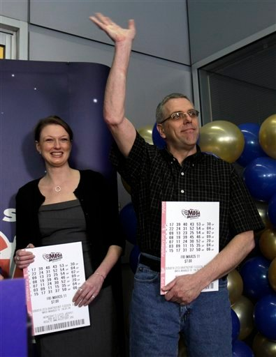 John Hilton, right, who shared in the $319-million Mega Millions lottery win, is introduced during a news conference in Schenectady, N.Y., Thursday, March 31, 2011. At left is Gabrielle Mahar, who was also one of the seven winners.