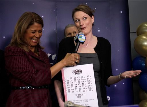 Gabrielle Mahar, right, who shared in the $319-million Mega Millions lottery win, talks with New York Lottery's Yolanda Vega during a news conference in Schenectady, N.Y.