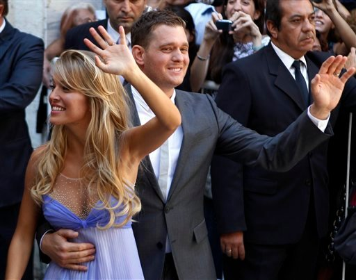 Canadian pop star Michael Buble and Argentine TV actress Luisana Lopilato wave to fans after their civil wedding ceremony in Buenos Aires, Argentina, Thursday March 31, 2011.