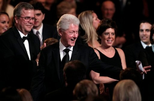 "Former President Bill Clinton arrives at the Kennedy Center, Monday, March 21, 2011, in Washington, before the ""All Together Now - A Celebration of Service"" performance in honor of former President George H.W. Bush."