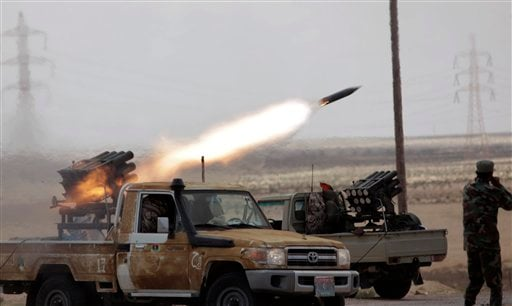Libyan rebels fire rocket launchers toward pro Gadhafi forces, along the front line outside the eastern town of Brega, Libya Thursday, March 31, 2011. (AP Photo/Nasser Nasser)