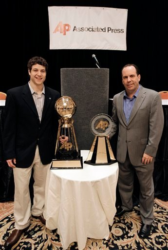 BYU's Jimmer Fredette, left, and Notre Dame's Mike Brey pose for a photo at a news conference Friday, April 1, 2011, in Houston. Fredette is AP player of the year while Brey was selected AP coach of the year. (AP Photo/Eric Gay)