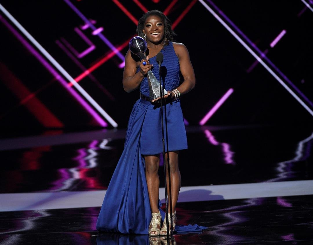 Gymnast Simone Biles accepts the award for best female athlete at the ESPYS at the Microsoft Theater on Wednesday, July 12, 2017, in Los Angeles. (Photo by Chris Pizzello/Invision/AP)