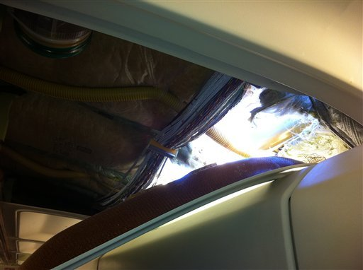In this photo provided by passenger Christine Ziegler, shows an apparent hole in the cabin on a Southwest Airlines aircraft Friday, April 1, 2011 in Yuma, Ariz. (AP photo/Christine Ziegler)