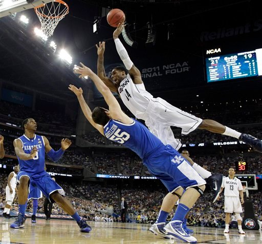 Connecticut's Alex Oriakhi loses the ball as Kentucky's Josh Harrellson defends during the first half of a men's NCAA Final Four semifinal college basketball game Saturday, April 2, 2011, in Houston. (AP Photo/David J. Phillip)