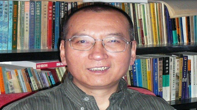 Chinese dissident Liu Xiaobo as he poses for a photographer in China.