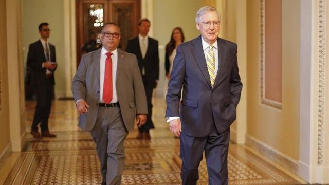 Senate Majority Leader Mitch McConnell of Ky. walks to his office on Capitol Hill in Washington Thursday, July 13, 2017. McConnell is planning on rolling out the GOP's revised health care bill, pushing toward a showdown vote next week with opposition with