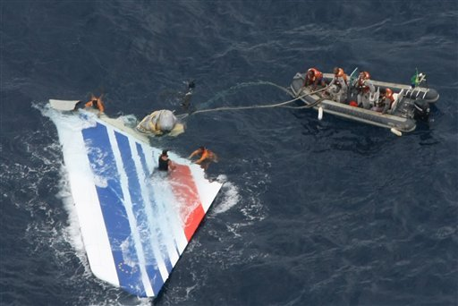 In this Monday, June 8, 2009 file photo released by Brazil's Air Force, Brazil's Navy sailors recover debris from the missing Air France Flight 447 in the Atlantic Ocean. (AP Photo/Brazil's Air Force, file)