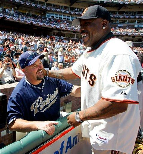 This April 3, 2007, file photo shows San Diego Padres pitcher David Wells, left, greeting former San Francisco Giants All-Star Kevin Mitchell during pre-game ceremonies on opening day in San Francisco.