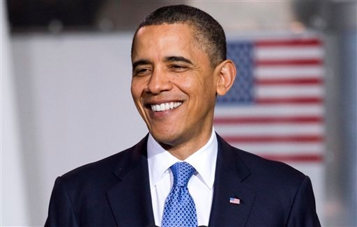 President Barack Obama smiles during an event to promote clean energy vehicles, Friday, April 1, 2011, at a UPS facility in Landover, Md.