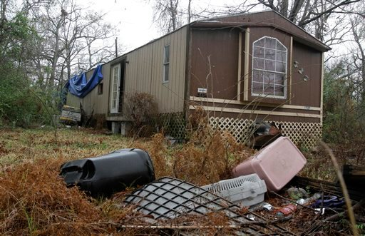 n this March 8, 2011 photo, trash sits outside an abandoned trailer in Cleveland, Texas where authorities say an 11-year-old girl was sexually assaulted in November 2010.