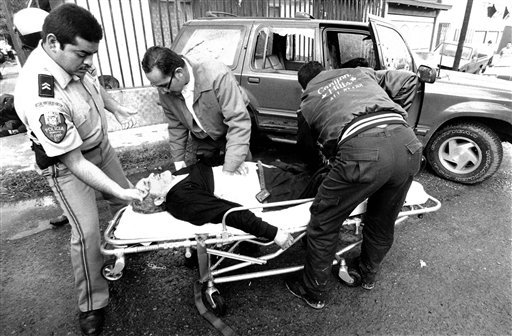 In this Nov. 27, 1997 photo, Jesus Blancornelas, one of the founders of Mexican weekly magazine Zeta, is aided after gunmen tried to kill him in Tijuana, Mexico.