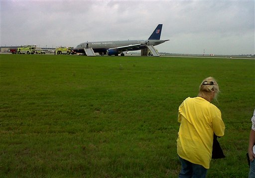 A United Airlines plane sits on a runway after making an emergency landing shortly after takeoff at Louis Armstrong New Orleans International Airport, Monday, April 4, 2011 in Kenner, La.