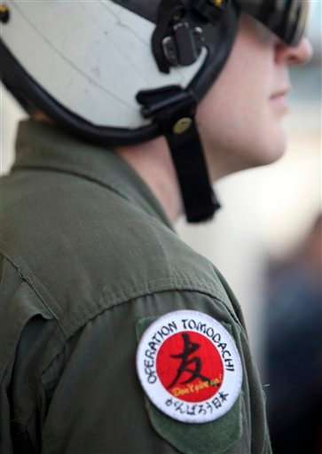 U.S. Navy personnel wears Operation Tomodachi badge on his shoulder.