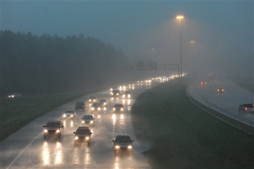 Motorists traveling Interstate 55 south at Fortification Street get pelted by heavy rain from the west as a line severe weather, bringing with it tornado warnings, moves through the metro area in Jackson, Miss, Monday, April 4, 2011.(AP Photo/The Clarion)