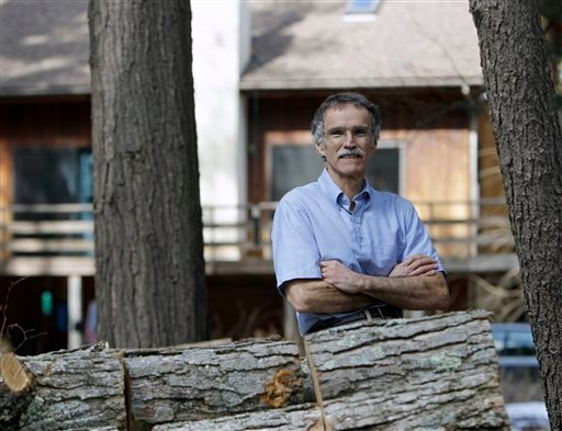Retiree Robert Rivers poses at his home in Ravena, N.Y., in this photo takenThursday, March 24, 2011.