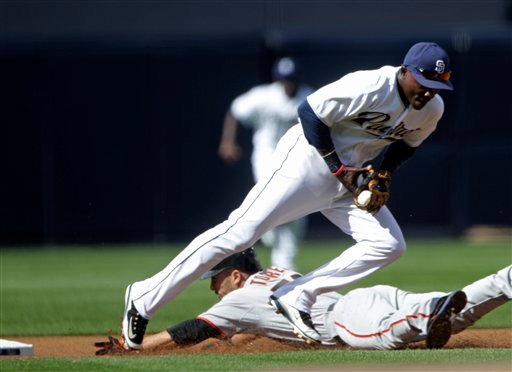 San Diego Padres second baseman Orlando Hudson corrals the late-arriving throw as San Francisco Giants' Andres Torres slides in with a stolen base in the first inning of a baseball game in San Diego, Tuesday, April 5, 2011.