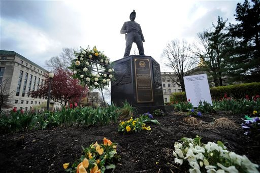 A wreath and a list of the 29 miners who died at the Upper Big Branch coal mine explosion are placed at the state coal miners' memorial on the first anniversary of the explosion Tuesday, April 5, 2011 in Charleston, W. Va.