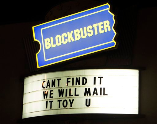 In this March 2, 2011 photo, signs at a Blockbuster store in Chicago are displayed.