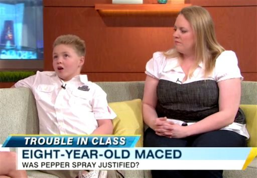 "In this frame grab from video released by ABC News/Good Morning America, Aidan Elliott, 8, and his mother, Mandy Elliott, appear on ABC's ""Good Morning America,"" Wednesday, April 6, 2011, in New York."