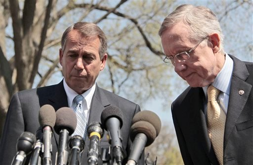 House Speaker John Boehner of Ohio, left, and Senate Majority Leader Harry Reid of Nev. meet with reporters outside the White House in Washington, Thursday, April 7, 2011, after their meeting with President Obama.