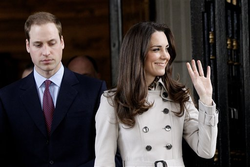 FILE - In this Tuesday March 8, 2011 file photo Britain's Prince William and his fiance Kate Middleton leave City Hall in Belfast, Northern Ireland.