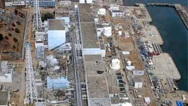 March 20, 2011 aerial file photo taken by a small unmanned drone and released by AIR PHOTO SERVICE, the crippled Fukushima Dai-ichi nuclear power plant is seen in Okumamachi, Fukushima prefecture, northeastern Japan. (AP Photo/AIR PHOTO SERVICE, File)