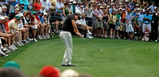 Phil Mickelson chips to the sixth green during the second round of the Masters golf tournament Friday, April 8, 2011, in Augusta, Ga.