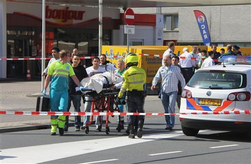 Injured people are carried out of a shopping mall after a shooting in Alphen aan den Rijn, 15 miles (25 kilometers) southwest of Amsterdam, Netherlands, Saturday, April 9, 2011.