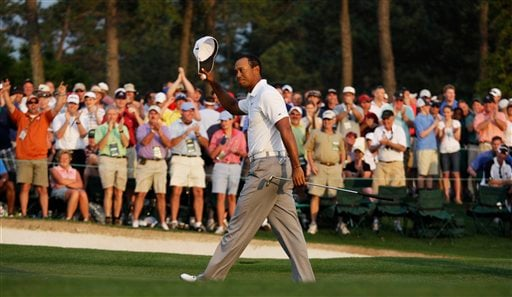 Tiger Woods tips his cap after finishing the second round of the Masters golf tournament Friday, April 8, 2011, in Augusta, Ga. (AP Photo/Charlie Riedel)