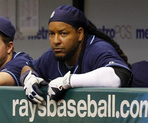 In this photo taken April 6, 2011, Tampa Bay Rays' Manny Ramirez watches from the dugout during a baseball game against the Los Angeles Angels in St. Petersburg, Fla.