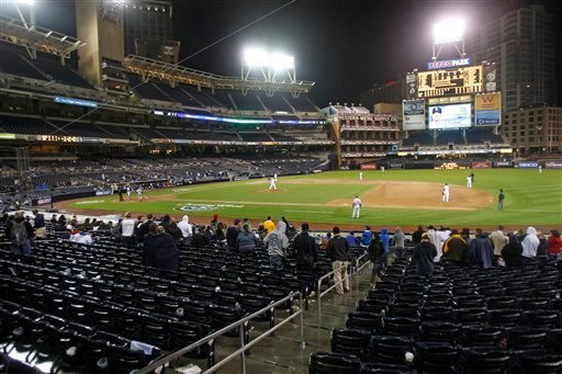 Only a small contingent of baseball fans remain in Petco Park after the second rain delay of the baseball game between the San Diego Padres and Los Angeles Dodgers pushed the game past 1:00 am in San Diego, Saturday, April 9, 2011.