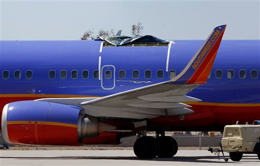 In this April 4, 2011 file photo, a Southwest Airlines plane sits in a remote area of the Yuma International Airport, after the plane had a section of fuselage tear from the plane during a flight on Friday, April 1, in Yuma, Ariz.