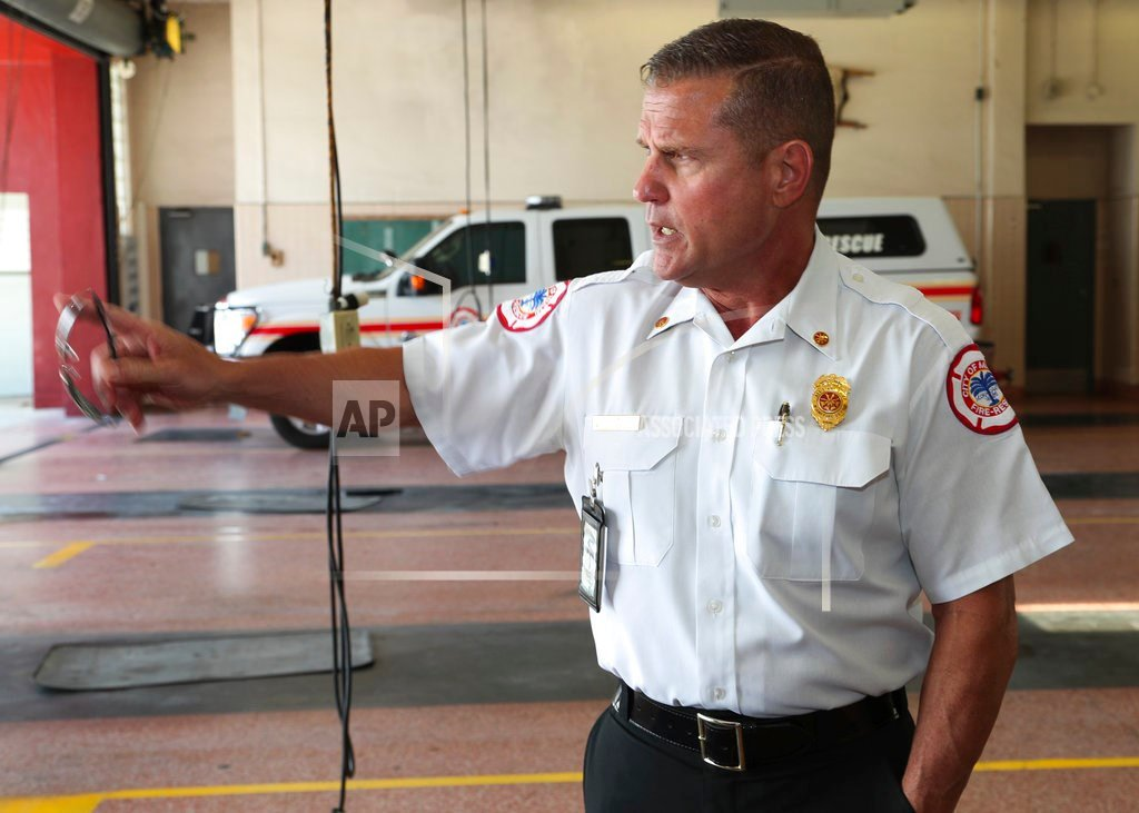 Assistant Miami Fire Chief Pete Gomez points to a location in front of the department during an interview on Tuesday, July 18, 2017. (AP Photo/Mario Houben)