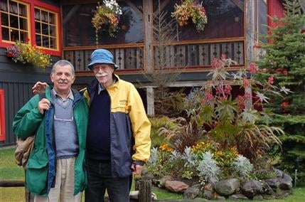 Sept. 2010 picture shows Tim Smulian, a South African citizen, left, and Edwin Blesch, an American, outside the Au Petit Poucet restaurant in Val David, Quebec, Canada. They married in 2007 in South Africa. (AP Photo)