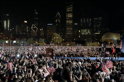 In this file photo taken Nov. 4, 2008 in Chicago, President-elect Barack Obama walks on stage with his family to speak at his election night party at Grant Park. (AP Photo/M. Spencer Green, File)